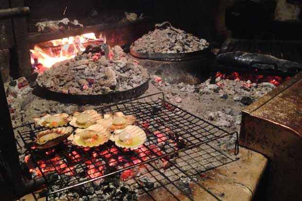Grilling shellfish on the fireplace
